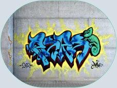 Het grijs van het beton met graffiti ingekleurd
